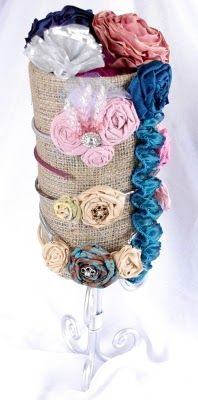 Bow holder - love the burlap! Wonder where I could find a stand like that?.