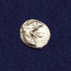 Ancient Greece, Ionia, Phokaia, AR Tetartemorion. Struck circa 521-478 BC. Head of griffin to right. Weight: 0.18 grams