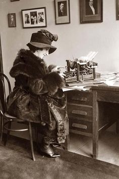 This is a photo from the 1920's showing a woman working at her desk, typing http://www.historynotes.info/the-changing-role-of-woman-in-20th-century-britain-2669/