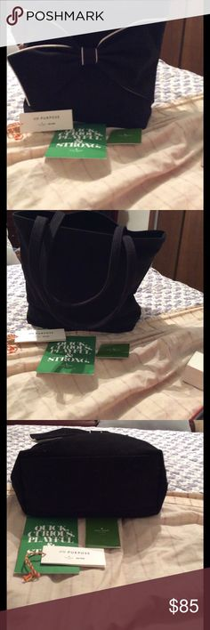 Black and White Trimmed Kate Spade Shoulder Bag. Gently Used Kate Spade Very Large On Purpose Canvas Tote Shoulder Bag. With her signature bow look. Great all purpose Bag. Can carry a iPad easily. kate spade Bags Shoulder Bags
