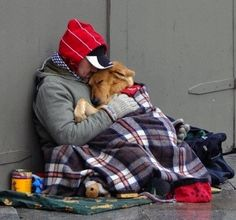 Even under the circumstances this makes me smile because of the love between this man and his dog.  This has got to be one of the most touching photos I've ever seen.