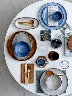 A table with wood accents and pops of blue using Sandrine ceramic tableware in blue from Bloomingville.
