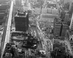 A south looking aerial image depicts the Twin Towers during construction in 1969.