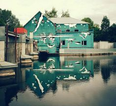 Artist Ray Bartkus wanted to incorporate Lithuania's Šešupė River into a captivating work of art, so he intentionally painted his mural upside-down. While
