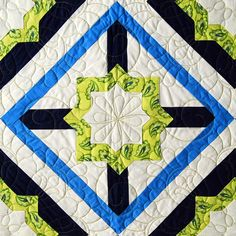 """Crossroads"" cross block from C&T Publishing's book ""Flip & Fuse Quilts"" by Marcia Harmening of Happy Stash Quilts"