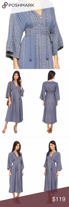 Free People Kimono Maxi Dress Modern Kimono Maxi Dress with graphic print. V lace-up neck, drawstring collar with tassel trim, Kimono sleeves, a-line hem, pleated waistband and shirring near the shoulders, all add well-tailored details to a flowy maxi dress fashioned after a traditional Kimono. 50 inch length, hidden side zip closure. 52% viscose 48% rayon 44-16-29-08-88-119 Free People Dresses