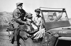 General Douglas MacArthur, in passenger seat wearing leather jacket, tours the newly opened Inchon Front in Western Korea on Sept. 19, 1950 during the Korean War. Accompanying him are, Maj. Gen. Edward M. Almond, left, Tenth Corps Commander, and Vice Adm. Arthur D. Struble, Fifth Fleet Commander. (AP Photo/U.S. Army Signal Corps) #