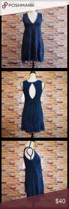 "Free People Floral Embroidered Dress Free People Floral embroidered dress in a size small.  Deep v neckline and dramatic keyhole back with button and loop closure.  Empire waist with ties.  Beautiful dress!  Measures bust 16"", waist 17"", length 32"".  100% viscose.  In excellent condition. Free People Dresses Mini"