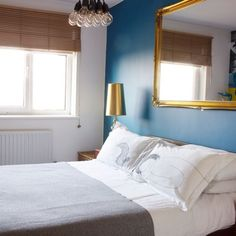 Neutral bedroom with blue feature wall