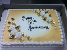 50th Anniversary cake -- I really like how this cake is decorated.  I'd prefer flowers with some color, though.
