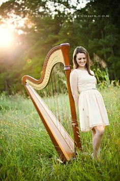 Mahogany Lyon and Healy Grand Petite 85; good idea for my senior pictures