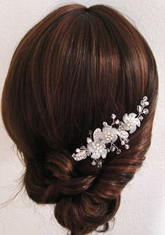 Wedding hair: formal low chignon with flower accessory #formal #updo #twist #sophisticated