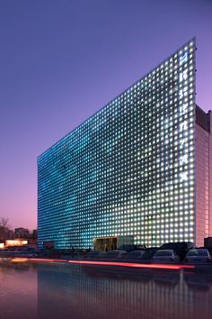 Xicui Entertainment Complex - media facade integrated with PV power generation; translucent PV modules and LEDs; power output: 38,929kWh/y; polycrystalline silicon; maybe for an otherwise boring south-facing wall... into a parking lot