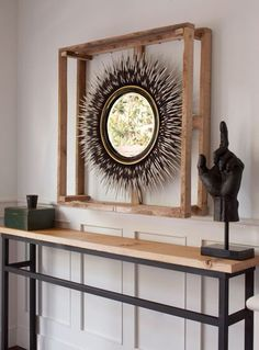 really like that console table (but not the hand or the porcupine quills-- to each their own)