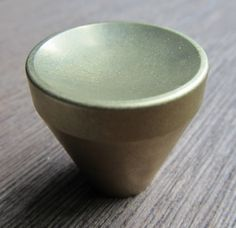 "The Varese decorative cabinet knob for either cabinet doors or drawers is supplied with a machine screw for through-bolting. It measures 1-1/4"" in diameter.  Also available in 1 1/2"", 1"", and 3/4""   Finishes available: Polished brass, Polished Bronze, Oxidized brass/bronze, Polished stainless steel, Satin stainless steel."