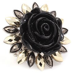 "This ring is adjustable and stretches to fit most ladies. It is of Formica construction and shaped like a rose with an antique, beaded finish. The ring is metal casting and is 1 1/2"" tall. Color: Black $19.99"