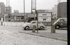 """Taken from East Berlin. The East Berlin DDR notice states that East Berlin (""""the democratic sector"""") ends 10 metres further on. The Western sector starts at the white railings bordering the pavement."""