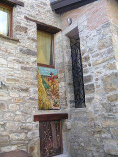 dipinto del maestro Cafferini sulla casa della surnia