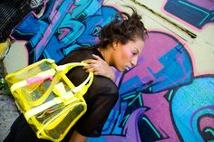 These clear purse features yellow accents and a small bow and a zipper closure. Clear Plastic Bags, Yellow Accents, Medium Bags, See Through, Shoulder Strap, Bows, Neon, Tote Bag, Purses