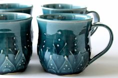 Beautiful mugs for your morning coffee or tea...    These unique and beautiful mugs are hand thrown from smooth stoneware clay and hand designed