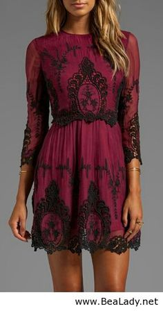 Black lace over one color dress I'd wear this with black tights and black shoes.