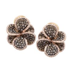 These stud earrings are beautifully crafted of 14-karat rose gold in the shape of flowers. The petals shimmer with brown and white diamonds, and simple saddleback clasps secure the earrings.