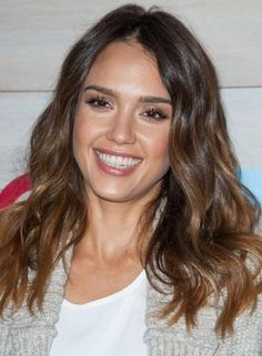 Jessica Alba's long wavy waves exude a very casual feel. Use a good spray for a wavy textured appeal. Wearing the style is easy and maintaining it is simpler.