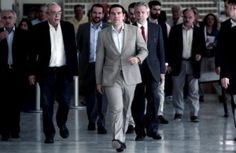 Greek Prime Minister Alexis Tsipras arriving at the ministry of Education today.