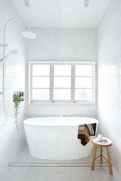 This restored worker's cottage in Brisbane's heart proves there's plenty to gain by honouring the past. With an internal redesign, clever window magic and a palette that focuses on improving light and space, the home has received a modern reinvention. Bathroom Colors, Bathroom Sets, Modern Bathroom, Small Bathroom, Bathroom Layout, Beautiful Bathrooms, Bathroom Interior, Bathroom Niche, Interior Door