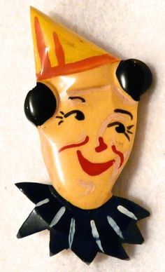 "whimsical Bakelite clown dress clip - measures 2-1/4"" by 1-1/2 - sold for $282 on eBay on July 6, 2014."