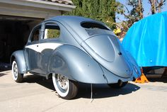 Partially through my restoration.  1956 ragtop sunroof VW Volkswagen Oval WIndow Beetle Kafer. The color is called Strato Silver (Stratosilber) and was originally offered on 1955 and early 1956 models. Original Foxcraft Skirts and Aussie Flash trim accessory. Note the Porsche 356 Brakes.