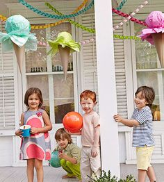 """These cute cone decorations set the scene for sundae fun. Plus, they are a piece of cake to make!                 What You'll Need: hole punch, 10.5"""" paper cones, fishing line, tape, 6"""" Styrofoam balls, tissue paper, hot-glue gun and glue sticks, Styrofoam block, craft knife, wooden skewer or thin dowel, scissors                 Make It: 1. Punch a hole on either side of the paper cone. Thread a piece of fishing line through each hole and secure line with a knot and a piece of tape inside…"""