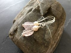 - Rose quartz and freshwater pearl earrings - Puffed ovals of rose quartz are paired with creamy white natural freshwater pearls on meticulously hand-knotted silver-plated ... #trending #etsy #etsymntt