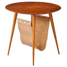 Round coffee table in pau marfim wood with magazine holder. Designed by Joaquim Tenreiro, Brazil, 1960s.