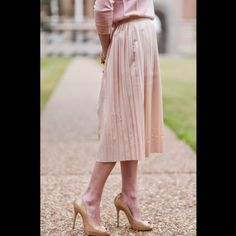 CCSJcrew Metallic Midi Skirt Color is Navy metallic but it looks mire like a gunmetal color), pleated midi skirt, back hidden zip, unlined. Material: cotton, viscose. Mint condition. All reasonable offers are welcome! Please make all offers through the offer button J. Crew Skirts Midi