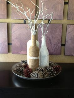 Add texture to a collection of wine bottles. This is a lovely projects with jute, just wrap wine bottles with jute to add pretty texture. Crafts To Do, Fall Crafts, Halloween Crafts, Diy Crafts, Wine Bottle Centerpieces, Wedding Wine Bottles, Centrepieces, Centerpiece Ideas, Name Decorations