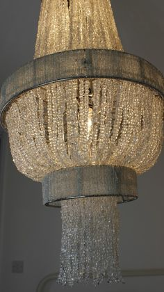 Chandelier < texture drapey and lazy... would prefer the patina be chrome/shinier...