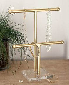 Litton Lane 10 in. x 14 in. Gold Metal and Acrylic Jewelry Holder 56989 - The Home Depot - Litton Lane 10 in. x 14 in. Gold Metal and Acrylic Jewelry Holder -