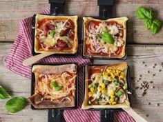 Viermal kleine Pizza aus dem Raclette-Pfännchen.