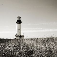 Black and white photograph of Yaquina head lighthouse in Newport, Oregon. This is a modern square print to give a unique look and feel to any ocean