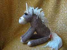 Here is a rare find. It is a genuine Unicorn come to earth to add a bit of magic. Made from original Rockford Red Heel Socks and filled with 100% pure polyester fiberfill, this little fellow measures about 7 at the shoulder and wears his own golden bridle. His magical horn is of Sock Material only, and is not sharp or stiff. He also has black button eyes and a black yarn nose to match. He is made with Rockford Red Heel Sock Monkey Socks and stuffed with 100% poly fiberfill. Ships USPS…