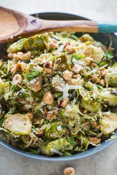Brussels Sprouts Salad with Hazelnuts, Parmesan, and Pomegranate Molasses Vinaigrette @blogoverthyme