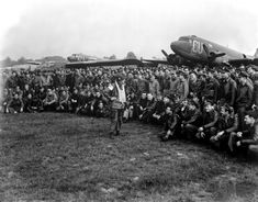 Brigadier General Anthony C. McAuliffe artillery commander of the Airborne Division gives glider pilots last-minute instructions in England for Operation Market-Garden on September 18 1944 before the take-off on D plus 1 of the operation. History Online, World History, World War Ii, Military Life, Military History, Military Photos, Motor Radial, Operation Market Garden, 101st Airborne Division