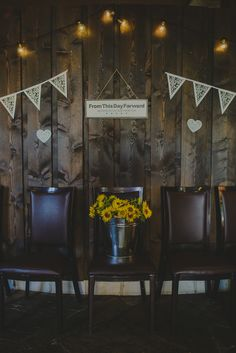 "Wedding decoration with sunflowers in a bucket, a lovely ""From this day forward"" sign, bulb lights and pennants // Hääkoristelu, jossa auringonkukkia sangossa, valkoisia viirejä, ""From this day forward"" -kyltti ja valoketju"
