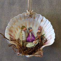 This Seashell 3 Wisemen Manger Scene Christmas Nativity Ornament is sure to be a favorite. This handmade Nativity Manger Scene Ornament was made here at Sea Things in Ventura, CA. This unique design w Seashell Christmas Ornaments, Mirror Ornaments, Nativity Ornaments, Christmas Nativity, Christmas Fun, Christmas Decorations, Nativity Scenes, Coastal Christmas, Box Decorations