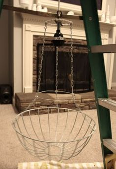 use a garden basket as a chandelier base. flush mount. Other idea: use a floral wreath frame.