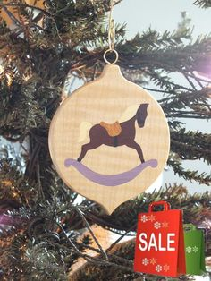 Beautiful Marquetry wood inlay Christmas ornament of Rocking Horse. Inlay woods are Ebony, Holly, Holly (Dyed Purple), Orange Osage and Rosewood,
