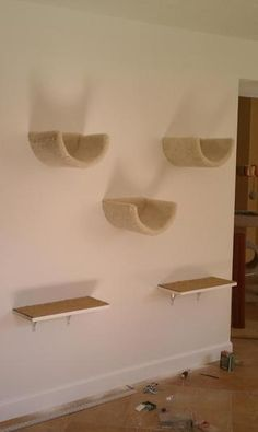 """Climbing wall with scooped beds and shelves. There were benches to be placed beneath the shelves to serve as the """"first step"""" up."""