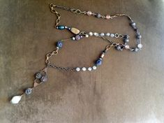 Vintage Beaded Long Chain Necklace, with vintage rosary, pearls, antique buttons and more -  Handmade Laineybean on Etsy.com The magic Bean Company
