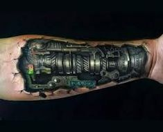 Biomechanical tattoos offer some of the most badass tattoo ideas for men. Even when they're done in a very graceful manner, gear and mechanical tattoo designs still pop for a…View Schulterpanzer Tattoo, Tattoo Arm Mann, Car Tattoos, Sick Tattoo, Badass Tattoos, Great Tattoos, Forearm Tattoos, Beautiful Tattoos, Body Art Tattoos